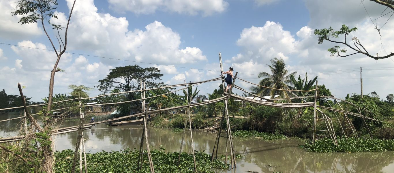 Try to cross on one of monkey bridges In Mekong Deta